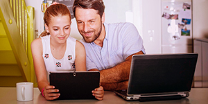 dad with daughter and laptops